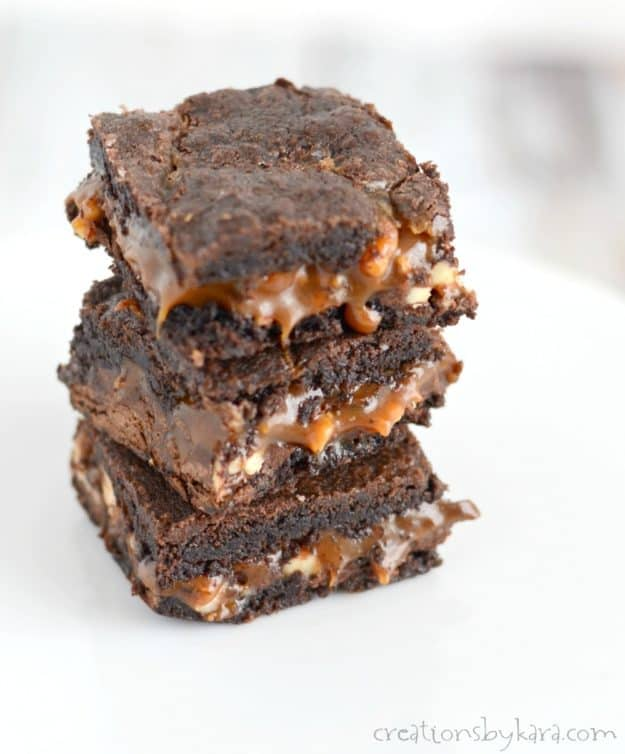 stack of brownies with melted caramel oozing out of the middle