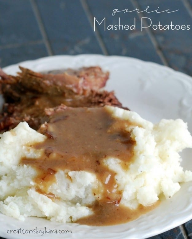 mashed potatoes with beef gravy on a white plate
