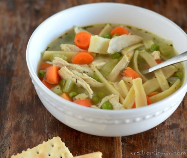 homemade chicken noodle soup with saltine crackers