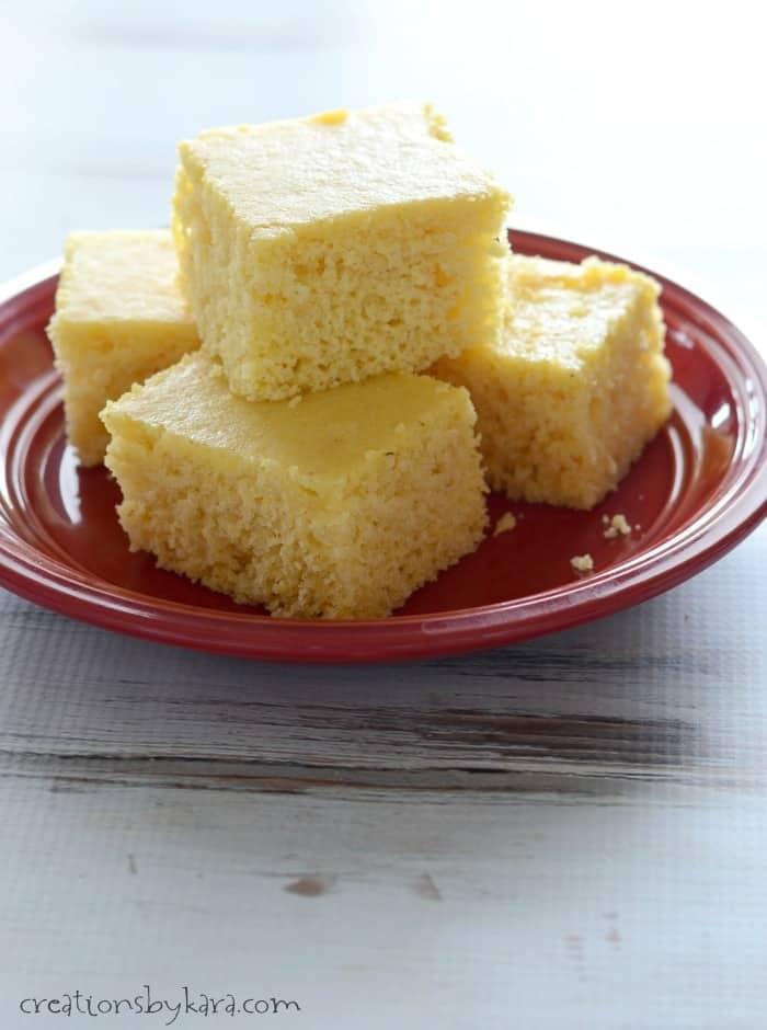 slices of sweet cornbread stacked on a plate