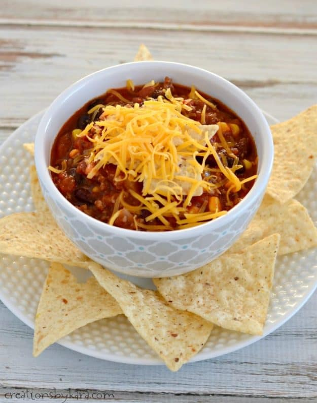 bowl of taco soup on a plate with tortilla chips