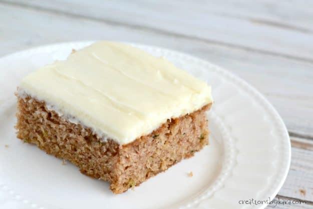 Homemade zucchini cake with cream cheese frosting.