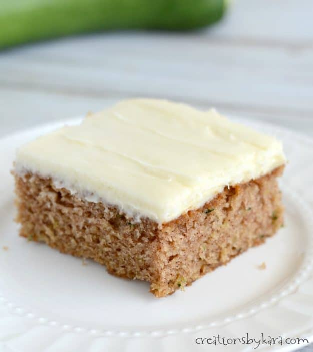 slice of the best zucchini cake recipe with cream cheese frosting