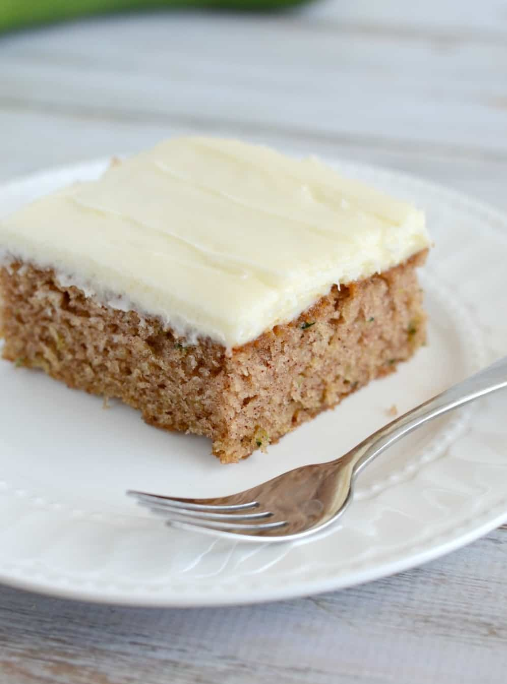 zucchini cinnamon cake on a plate with a fork