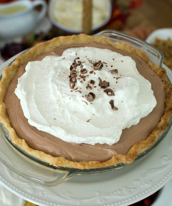 creamy turtle pie topped with whipped cream