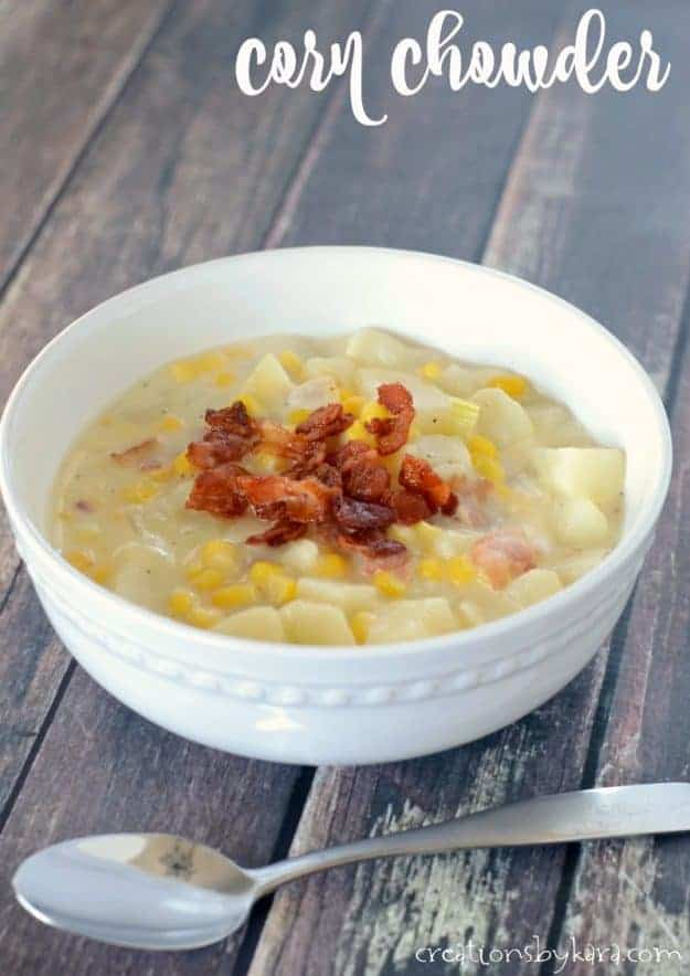 bowl of corn chowder with bacon on top