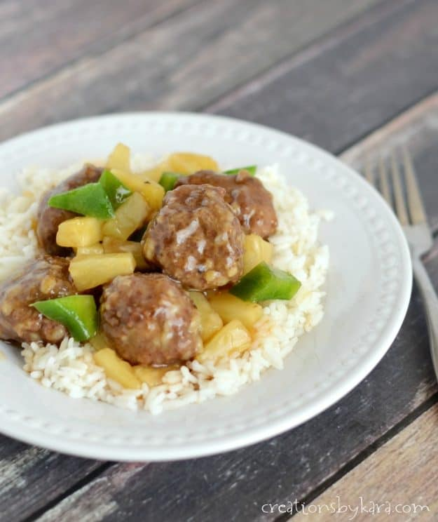 plate of meatballs with pineapple and green peppers over rice