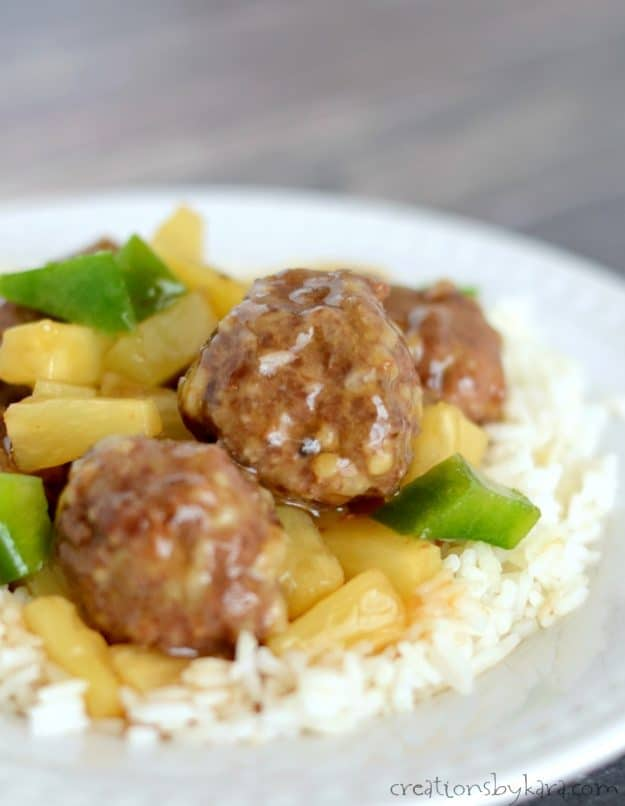 close up shot of meatballs with sweet and sour sauce