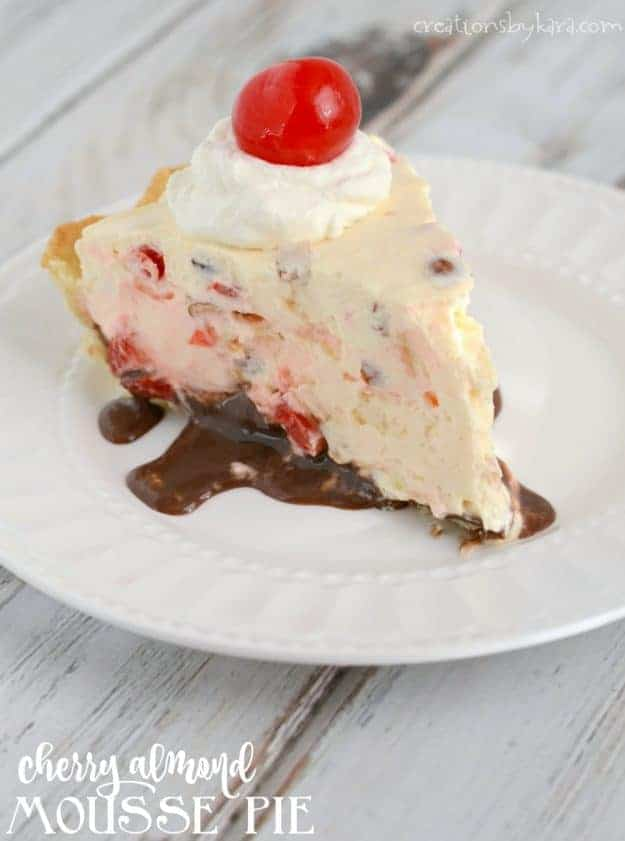 Recipe for cherry almond mousse pie - a no-bake cheesecake with fudge, cherries, and almonds.