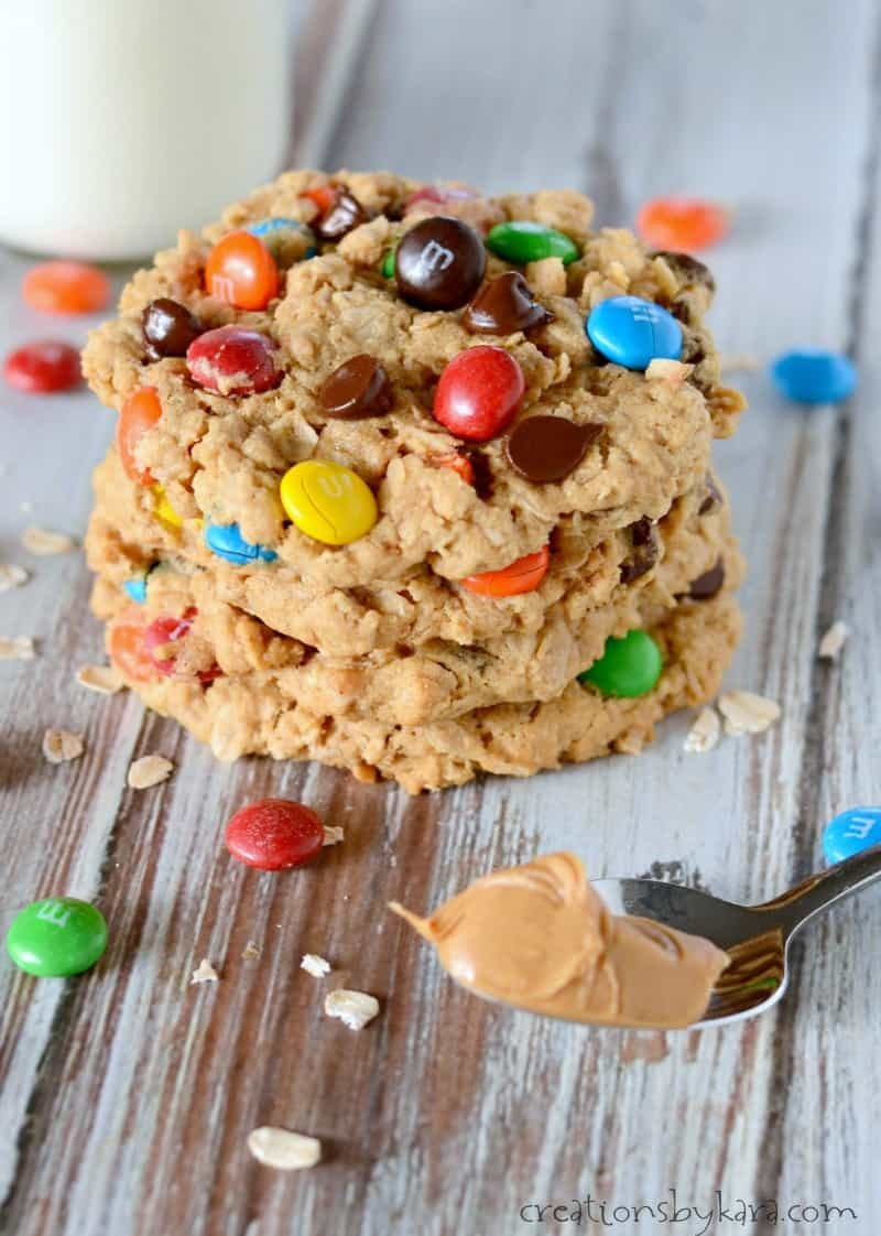 stack of Oatmeal peanut butter cookies with M&M's and a spoonful of peanut butter