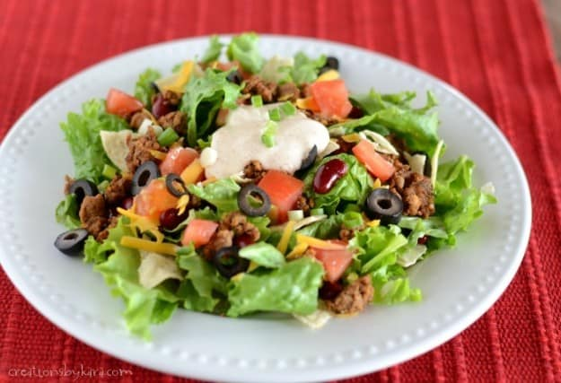 plate of taco salad on a red placemat