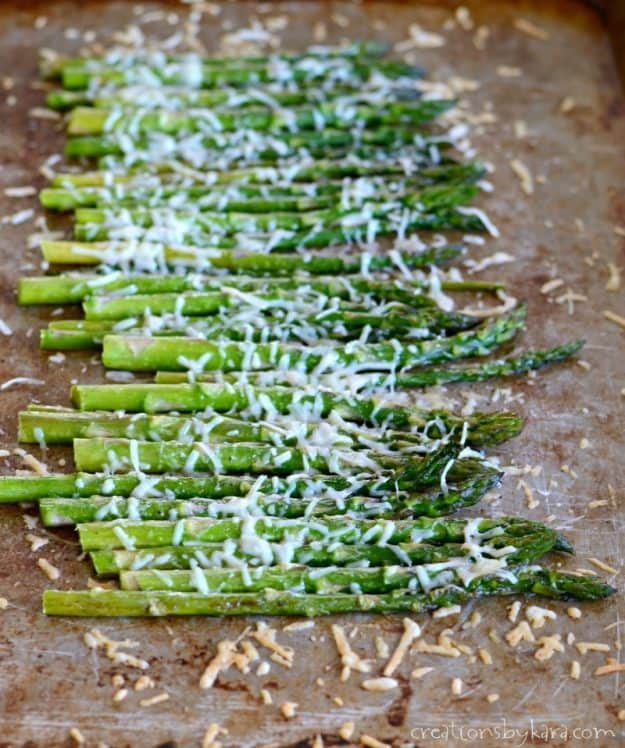fresh asparagus roasted on a cookie sheet