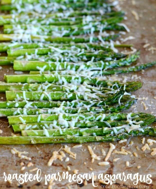 easy roasted asparagus with parmesan on a cookie sheet