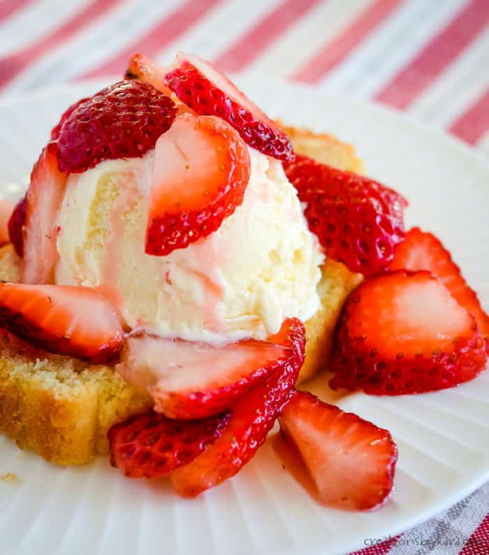 plate of strawberry shortcake with homemade pound cake and vanilla ice cream