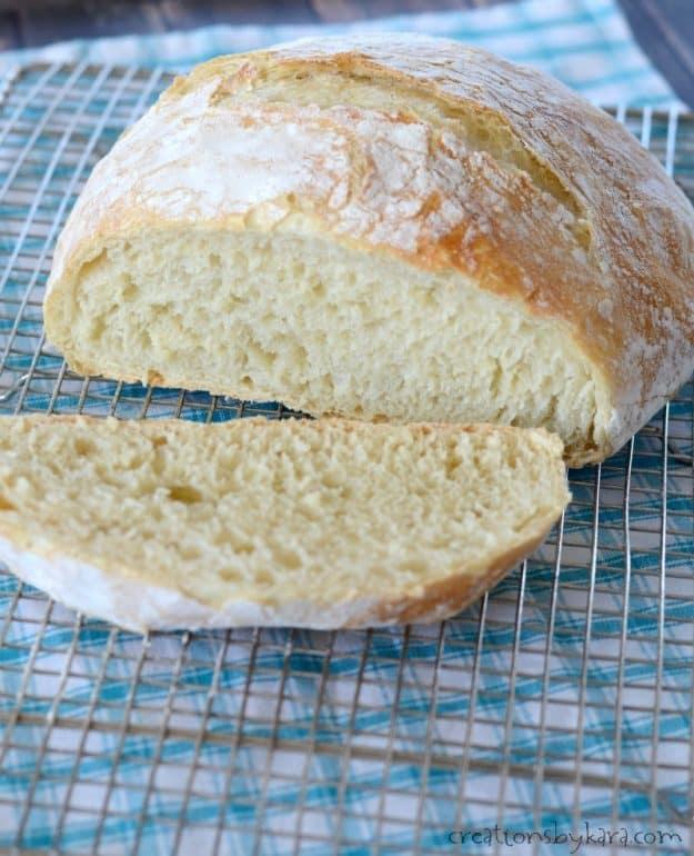 sliced loaf of artisan bread on a cooling rack