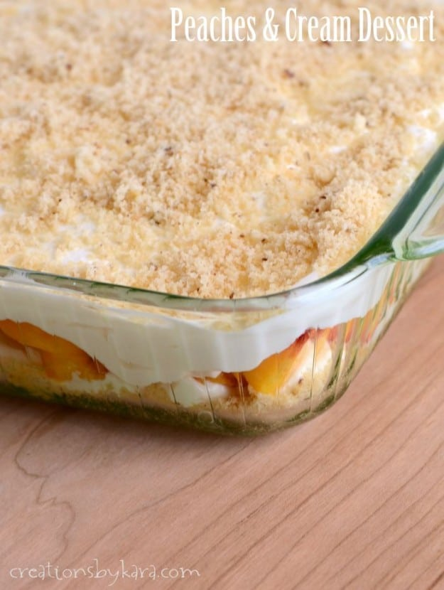 Layered peaches and cream dessert in 9x13 inch pan
