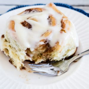 ooey gooey yeast cinnamon roll with cream cheese frosting