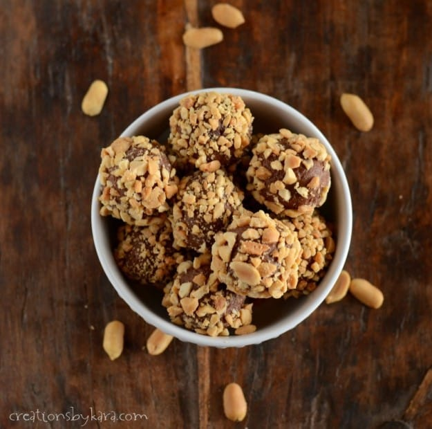 chocolate peanut butter truffles rolled in peanuts sitting in a bowl