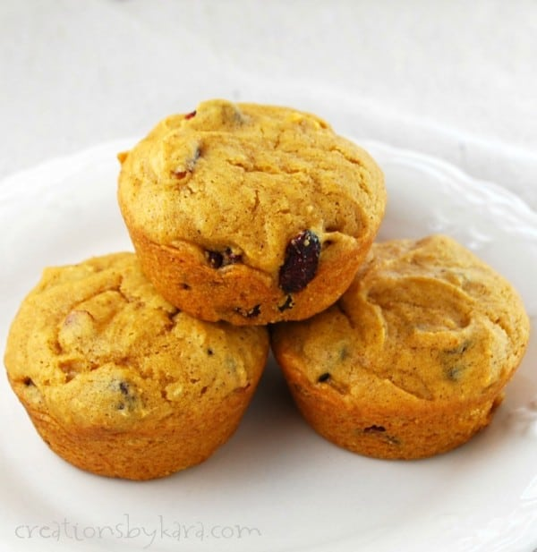 pumpkin cranberry muffins on a plate