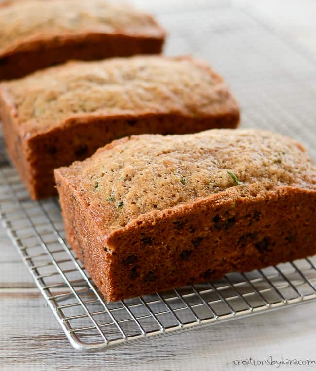 loaves of chocolate chip zucchini bread on cooling racks