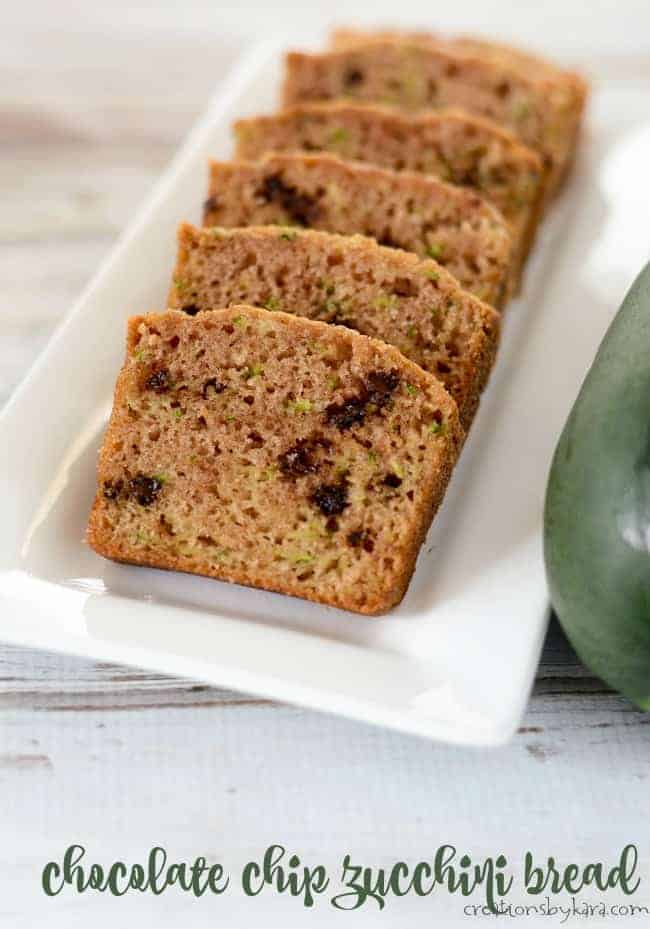 slices of chocolate chip zucchini bread on a serving tray