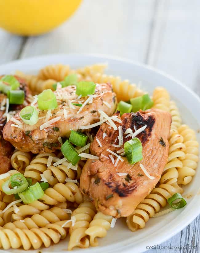 chicken pasta with lemon garnished with green onions