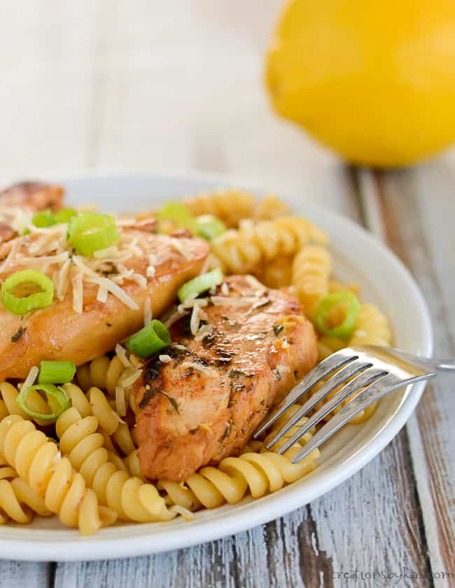 lemon chicken pasta on a plate with a fork