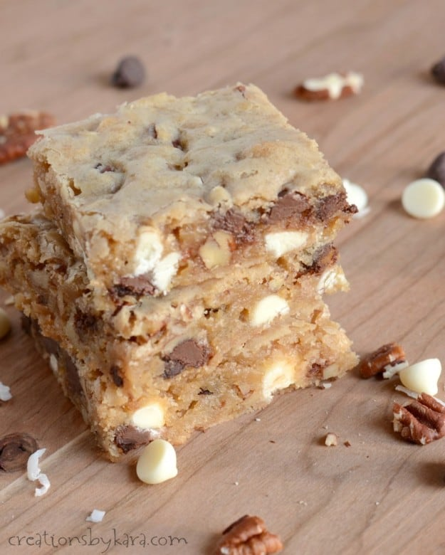 Blondies with two kinds of chocolate, coconut, and nuts. Chewy and amazingly delicious!