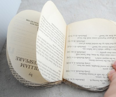 glueing the pages of a book to make a pumpkin