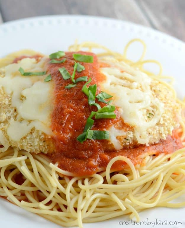 close up of pasta and breaded chicken with marinara sauce
