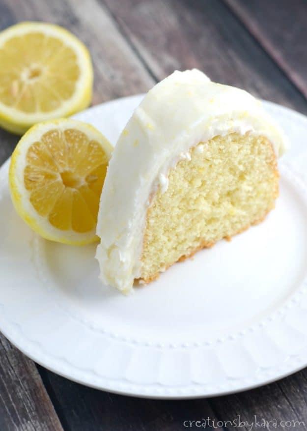 lemon cake on a plate with lemons