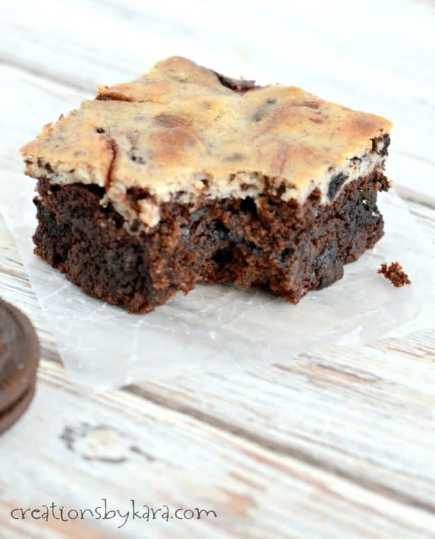 oreo cheesecake brownie with a bite taken out of it