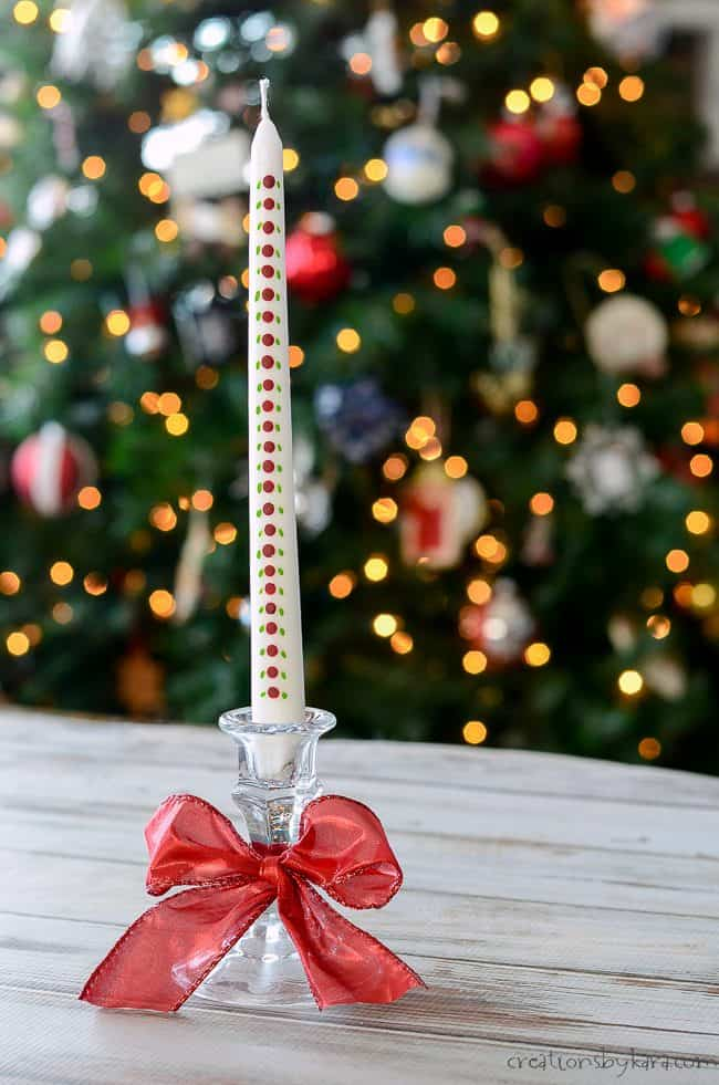 christmas advent candle in front of Christmas tree