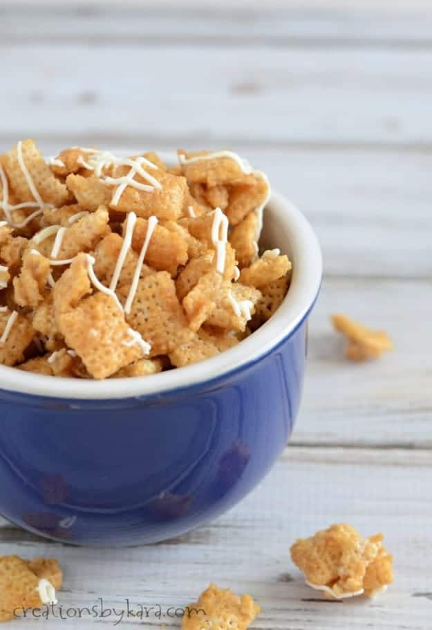 bowl of cinnamon chex mix drizzled with white chocolate