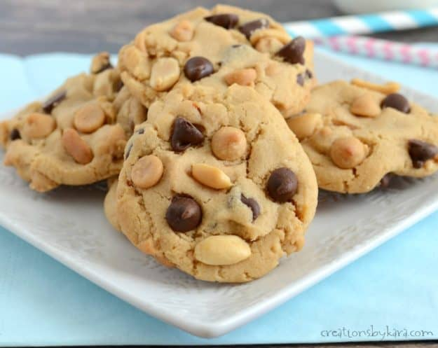 plate of peanut butter cookies with peanuts, chocolate chips, and peanut butter chips