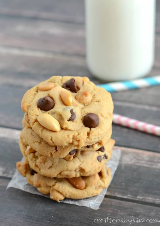 stack of peanut butter chocolate chip cookies with a glass of milk