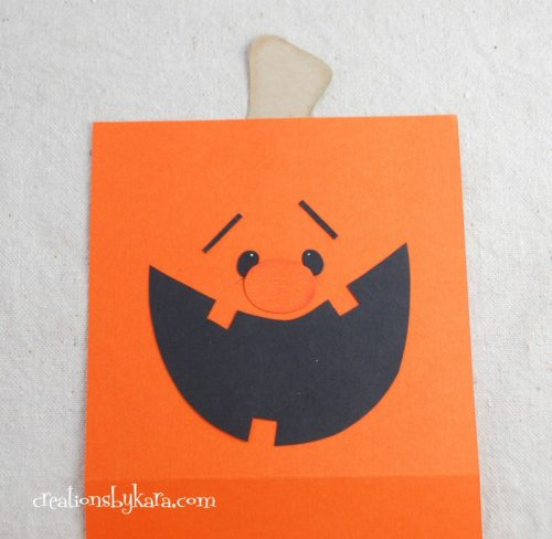 Paper pumpkin treat bag with free printable pattern.