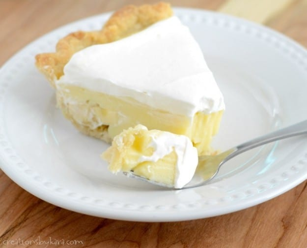 plate of banana pudding pie with a fork