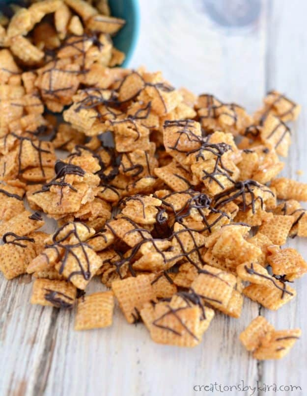 chex coated with caramel and drizzled with chocolate