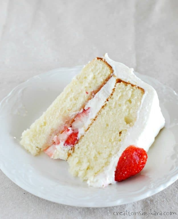 Slice of Strawberry Cake with Cheesecake Frosting - a fluffy and tender cake with decadent frosting. So yummy!