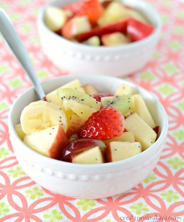 honey lime dressing with fruit in a white bowl
