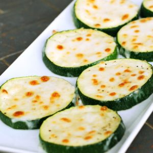 zucchini topped with parmesan and mozzarella cheeses
