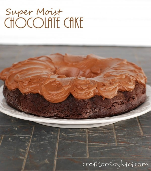 chocolate cake with chocolate frosting on a cake plate