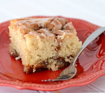 Pockets of cinnamon sugar and a vanilla glaze make this Cinnamon Roll Cake the perfect comfort food. Everyone loves this cake!