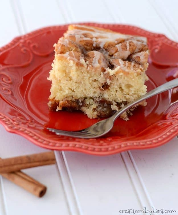 Serve this cinnamon roll cake warm and the icing melts down into the pockets of cinnamon sugar. Comfort food at its best!