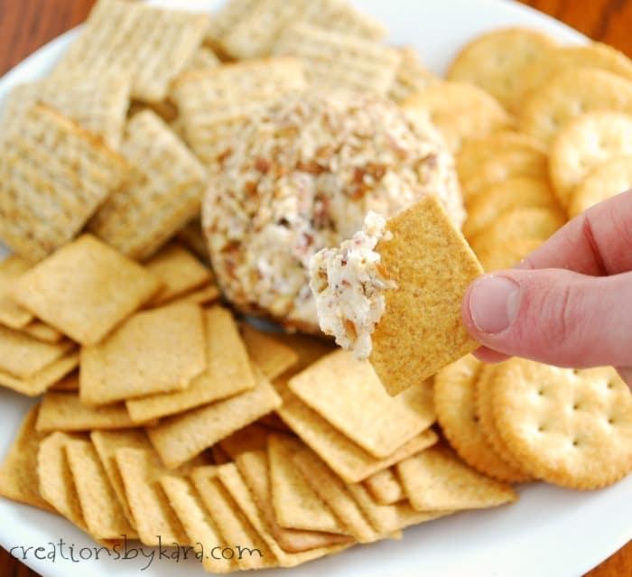bacon cheddar cheese ball on a cracker