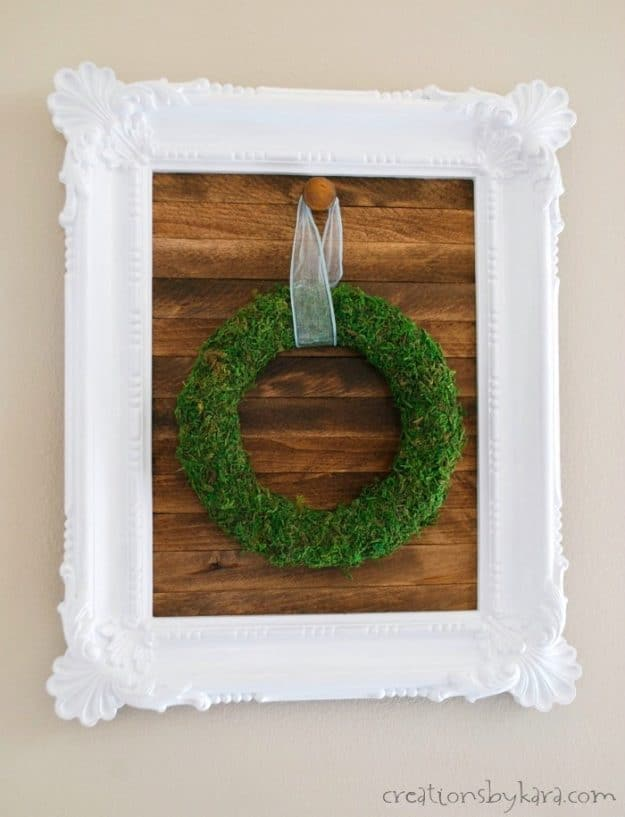 How to make a farmhouse framed sign for hanging wreaths. A fun diy decor project!