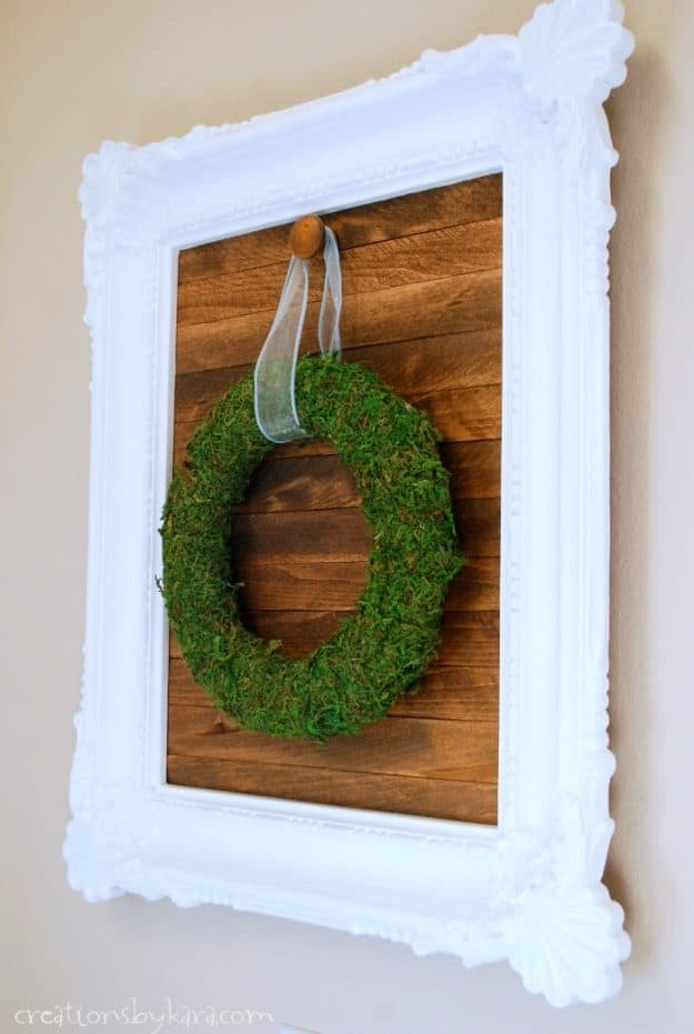 Make a wood slat sign for hanging seasonal wreaths. A fun and easy diy decor project.