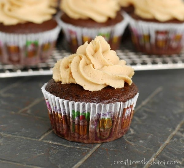 Peanut butter stuffed chocolate cupcakes with peanut butter frosting