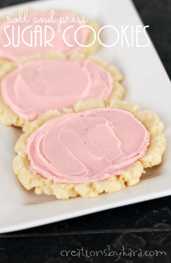 frosted shortbread cookies on a tray